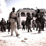 Dirty Wars Film Still Members of a Western-backed Somali militia walk through Mogadishu